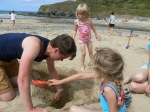 Philip digging a hole with Abi